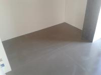 Bodengleiche-Dusche-aus-grossformatigen-Fliesen